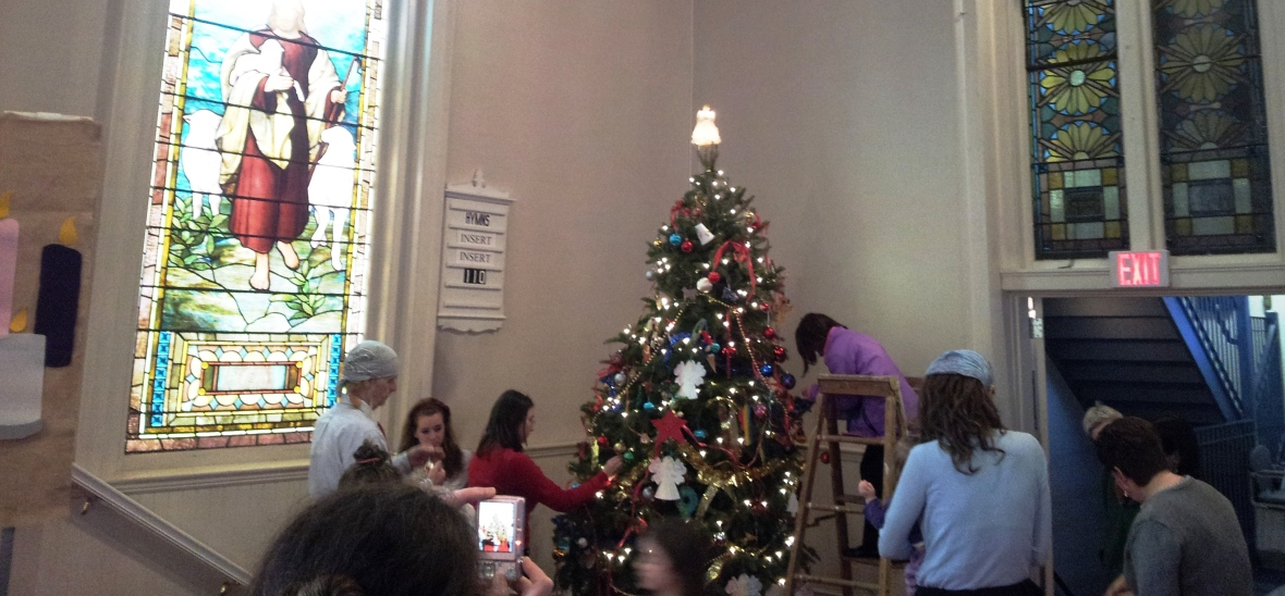 The congregation works together to prepare the sanctuary for Advent.